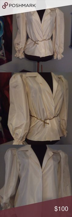 "VINTAGE OSCAR DE LA RENTA BLOUSE BEAUTIFUL DEEP IVORY BLOUSE WHICH CAN BE CROSSED OVER AND TUCKED INTO A SKIRT OR PANTS GREAT FOR EVENING WEAR LOVELY BIG PUFFY SLEEVES NO BUTTON FRONToscar SIMPLE YET ELEGANT CHEST 36"" SHOULDERS 15"" LENGTH 25"" MADE FOR SAKS FIFTH AVENUE  #oscardelarenta #vintage # 80'sblouse #runwayblouse OSCAR DE LA RENTA Tops Blouses"
