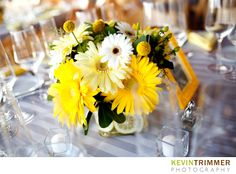 Wedding reception centerpiece and table decor. Yellow and white color scheme. www.kevintrimmer.com
