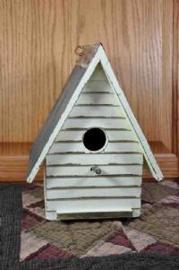 Primitive Country Birdhouse Enjoy the simple charm displayed when you add this Primitive Country Birdhouse to your decor. This clap board birdhouse is made from wood, painted white with an antique fin