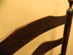 -five concave and reverse graduated thin slats (the top slat has the top piece broken off - old break)  -slats all are fastened at the back of the chair with 10 square  hand forged iron pins