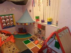 Great version of a sensory board filled with ideas and toys to keep occupied!