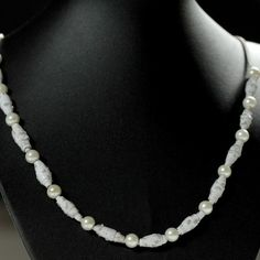 Unique handmade necklace made of recycled paper in white and pearl beads in white.