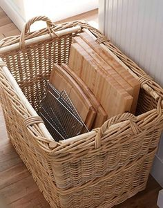 Keep cutting boards and racks in tall baskets. | 51 Game-Changing Storage Solutions That Will Expand Your Horizons