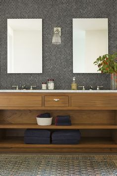 21 natural bathroom with black and grey penny tiles in the sink area - DigsDigs