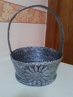 cesta plateada,hecha por Jose Arce
