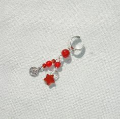 """This listing is for one handmade non-pierced sterling silver ear cuff. Features red agate gemstone beads and tiny pewter pentagram charm! Will fit any ear! Dangles 1.25"""" long!"""
