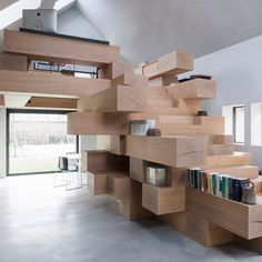 Antwerp-based practice Studio Farris has integrated an office into a staircase made from stacked timber beams in an old barn in West Flanders, Belgium