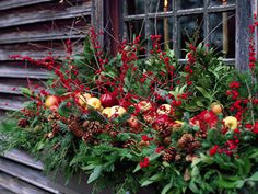 Christmas window box. I'm gasping at how GORGEOUS this is! I may do this in Mayleigh's window flowerbox thing.