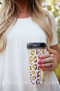 For the fancy coffee lover! This is a 16oz. travel mug with white and gold shiny leopard print. Hand wash only; do not leave submerged in water. Miss Fancy Fox Exclusive!