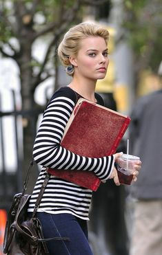 Margot Robbie - laptop cover that looks like antique book