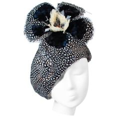 View this item and discover similar for sale at - This Jack McConnell hat s composed of a stunning array of feathers in navy and cream hues with petite spotted feathers. Features a large flower with rhinestone Hats For Men, Ladies Hats, Navy Hats, Wedding Guest List, Feather Hat, Church Hats, Rhinestone Appliques, Flower Hats, Winter Hats