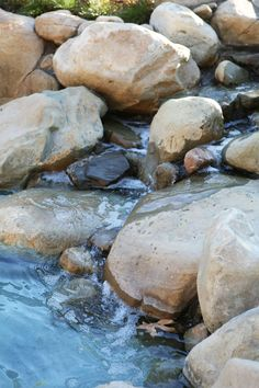 Poured in place boulders have been recreated to look identical to a natural boulder that you will find in streams. Concrete Patios, Flagstone, Fire Pit And Pond, Pond Ideas, Stamped Concrete, Dream Pools, Pool Decks, Happy Things, Wall Ideas