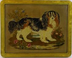 """finely done needlwork of a king charles spaniel measures 17 1/2"""" x 22 1/2"""" . The frame measures 20 1/2"""" x 25 1/2"""""""
