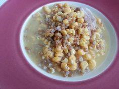 Caldo de millo y trigo Ingredientes para 4 personas 1/2 kg.Millo, 300gr. Trigo, 200 gr. Tocino, 500 gr.Costillas de cochino, 2 Hojas de laurel, 300 gr.Garbanzos,2 gr. Tomillo, 200 gr.Cebolla, 2 Litros de Agua, 2 cl. Aceite de oliva, ½ kg.Papas, 1 Tomate maduro, 1/2 Cabeza de Ajos, 1 gr. Comino, 1/2 Sobre de Azafrán, 3 gr. Sal gorda.