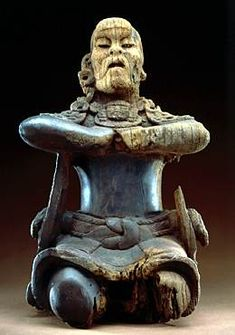 This extremely rare wooden figure may once have held a square mirror, and the figure's pose suggests a trance state associated with divination. Wood rarely survives in the tropical climate in which the Olmec and Maya civilizations flourished.    Kneeling Figure  Wood and hematite  Basalt  38 cm  The Metropolitan Museum of Art, the Michael C. Rockefeller Memorial Collection, Bequest of Nelson A. Rockefeller