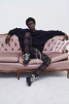Lounging, Adonis Bosso sports plaid pants and a sweatshirt with boots from Fear of God's fall-winter 2017 collection.