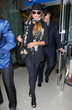 Chrissy Teigen makes a stylish arrival at LAX after Europe trip - Celebrity Fashion Trends