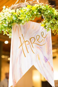 hanging banner table number, photo by Tami Melissa Photography http://ruffledblog.com/the-notwedding-nyc-ii #tablenumbers #weddingideas