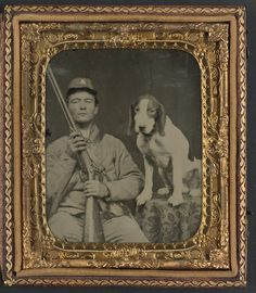 [Unidentified soldier in Confederate uniform with shotgun sitting next to dog] (LOC) American Civil War, American History, American Soldiers, Confederate States Of America, War Image, War Dogs, Civil War Photos, Vintage Dog, Us History