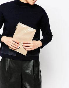 Classy nude clutch perfect for a white jumpsuit or white New Years Eve dress. Find it here: http://asos.do/vwWOS6