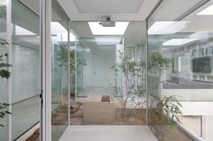 Lovely simple bath inside tiny courtyard. younghan chung studio archiholic 9x9 experimental house