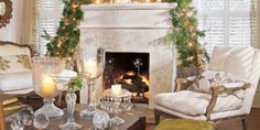 For Charlotte Comer's living room in Dallas, florist Bryan Long decided to take the Christmas decorations to new heights—literally.  Two slim cedars threaded with lights and Venetian glass bells frame the fireplace mantel just below the ceiling's whitewashed beams to dramatic effect.  - Veranda.com