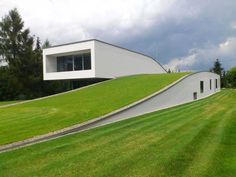 "The Auto-Family House features a garage entranceway designed ""into"" the earth"