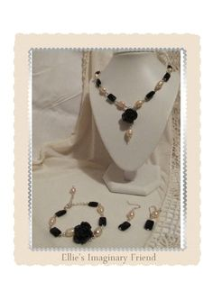 This necklace is made from peach CFW Pearls, black onyx and polymer flowers with silver plated findings. It is made of several links to give it fluidity x