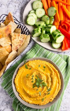 Chipotle Carrot Hummus: naturally sweet carrots and smoky chipotle chile powder makes this nutritious hummus sweet, spicy and delicious! It takes 15 minutes to make and it's the perfect healthy dip for spring and summer.