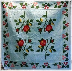 Beautiful applique!  Quilted by Karen Marchetti of Creative Longarm Quilting