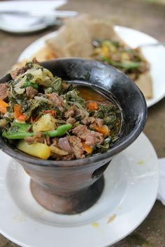 Gomen Be Siga - Tasty Ethiopian Sizzling Beef and Greens - http://migrationology.com/2014/01/gomen-be-siga-ethiopian-food/