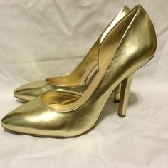 Metallic gold BCBG Paris stiletto pumps 7.5  Selling this lovely pair of 7.5 gold BCBG Paris pumps. These have been worn exactly once on New Year's Eve of 2014. The soles reflect only slight wear, and the gold leather upper is in near-perfect condition. The insides are totally clean. Pair these with a sequin dress, and strut to your NYE party in these cuties! BCBG Shoes Heels