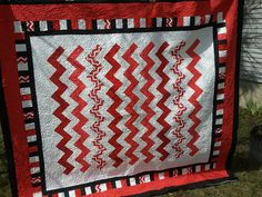 Red and white chevron quilt, made to order  https://www.etsy.com/listing/184429052/new-handmade-red-and-white-zig-zag-quilt