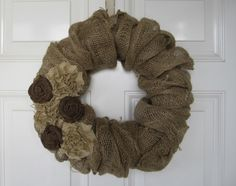 burlap wreath tutorial (also tutorial on how to make the flowers!)  So disregard that this isn't the most beautiful wreath, and combine the knowledge of how-to basics with prettier final products