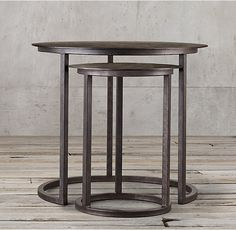 RH's Mercer Round Nesting Tables:A design from the late 20th century, our Modernist metal table has the pared-down aesthetic of the industrial original. Built entirely of metal, it has a silhouette ring base that echoes the shape of the circular disc top.
