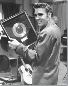 The one millionth record of Heartbreak Hotel is presented to Elvis Presley by RCA Victor, April 1956.