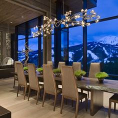 Gorgeous chandelier above the dining table Private Luxury Ski Resort in Montana by Len Cotsovolos Dining Table Chandelier, Chandelier Design, Dining Table Design, Dining Area, Modern Chandelier, Branch Chandelier, Chandelier Lighting, Dining Rooms, Modern Mountain Home