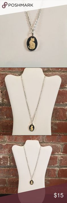 """Silver plated cat cameo pendant necklace Silver plated black cat resin cameo pendant necklace. Chain is 18"""" pendant is 1"""". Chain length can be customized if desired. Perfect piece of fashion jewelry Custom Jewelry Necklaces"""