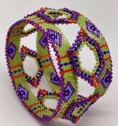 Nancy Jenner - two narrow bracelets embellished with bw shapes