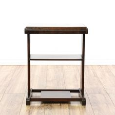 This end table is featured in a solid wood with a glossy dark mahogany finish. This Art Deco style side table has 3 tiers, a box stretcher base, and rounded top. Perfect for holding a lamp and more! #americantraditional #tables #endtable #sandiegovintage #vintagefurniture