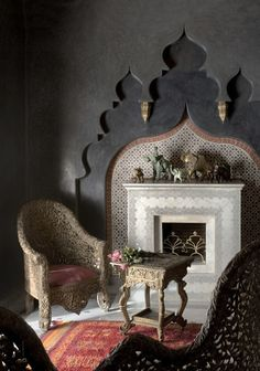 WOW!! Would love to have this in the house- understated glamour- especially love the colour which gives the arches such a modern look. Moroccan fireplace