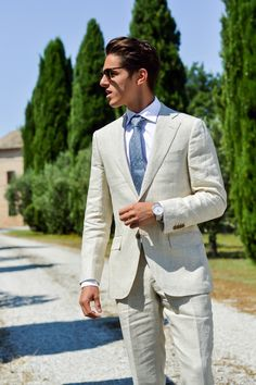 Light beige subtle checkered pattern suit + speckled blue tie