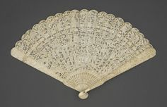 Brisé Fan | China, circa 1800. Ivory sticks, mother-of-pearl button, brass metallic rivet.