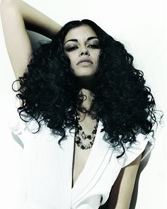 A long black curly frizzy frizzed tight-curled messy Ethnic Mov Womens Black hairstyle by Heading Out