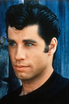 "John Travolta as Danny Zuko | Here's What The Cast Of ""Grease"" Looks Like Now. HAHAHA not one of them aged gracefully..."