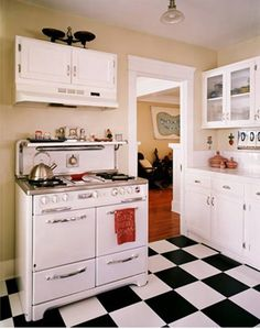 retro vintage kitchen - love the black & white floor in kitchen & wood floor in the other room
