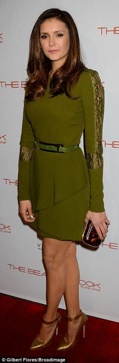 Blending colours: Nina matched her pea-green dress with a pair of gold heels...