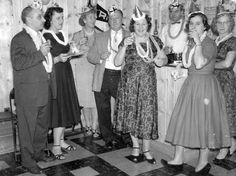 A group of friends get into the swing of celebrating in this fun 1950's New Year's Eve photo....