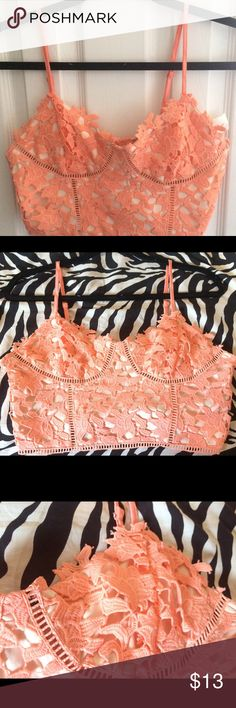 Crochet Lace Peach Bustier Like Crop Top Brand new with tags! Cream and peach. No padding. 4th picture shows the lining of the top. Naturally fringed. Just the style of the top! Mistique Tops Crop Tops