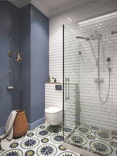 Keep your wall tiles simple and make a statement with gorgeous patterned floor tiles. #BathroomIdeas